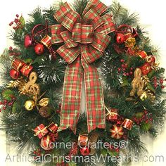 Christmas Symphony Wreath - 2013 - Our beautiful Christmas Symphony Wreath has an assortment of colorful instruments and gift wrapped packages on a beautiful mixed fir base. The look is completed with a gold-trimmed, red and green plaid bow. - #ArtificialChristmasWreaths #ChristmasWreaths #Wreath #Wreaths #Christmas