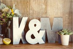 bride and groom initials set up on the sign in table