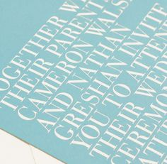 Our Aquamarine invitation is shown here in detail, foil stamped and letterpress printed.