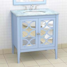 This furniture-like sink console features a baby blue finish and mirrored doors for an Old Hollywood-style glamour feel. | Photo: Courtesy of The Furniture Guild | thisoldhouse.com baths, bathroom mirrors, color, vaniti idea, furnitur guild, bath vanities, paint, baby blues, babi blue