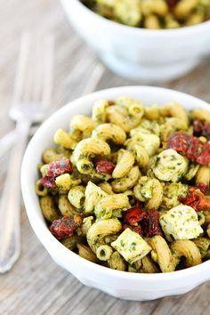 Pesto Chicken Pasta with Sun-Dried Tomatoes Recipe on twopeasandtheirpod.com So easy and SO good!