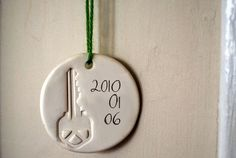 Impression of the key to your first home together as an ornament. Love it!