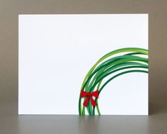 Christmas cards - replicate by dipping the rim of a mug in different shades of green paint and add red ribbon.
