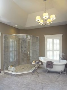 Sherwin Williams Keystone Gray - a nice contrast with the gray tiles... http://www.bathroom-paint.net/bathroom-paint-color.php