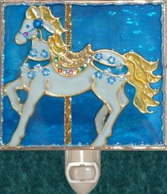 Royal Blue Carousel Horse Night Light. Stained glass nightlight hand painted on textured art glass for carousel gifts and theme decor. Decorative creative artwork made by Pat Desmarais in the USA. $25.00 night lights, carousel horses, stain glass, stained glass, glass nightlight