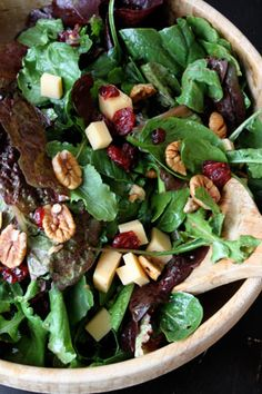 Thanksgiving Harvest Salad ... •Fresh spinach  •Arugula  •Red lettuce  •Handful of pecans (or walnuts)  •Handful of dried cranberries  •Handful of cubed smoked gouda cheese  •A sweet dressing like maple fig or raspberry vinaigrette dressing, just a bit.  Throw everything in a bowl and toss!  (I think I'd add some diced apple too this as well.)