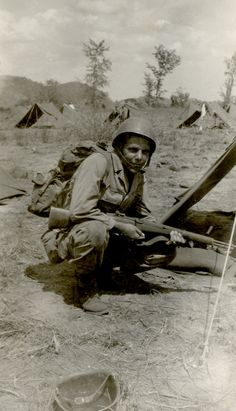 American soldier with M1 Garand rifle in the Philippine Islands, circa 1945