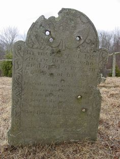 Bullet Holes in Gravestone: Avery Denison