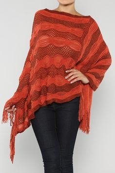 Relaxed Soft Knit Poncho with a touch of fringe.