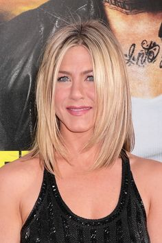 """Jennifer's new look is the same middle part and no bangs but she has taken it to shoulder length. The graduated layers around her chin help to frame her face. The bottom of this hairstyle has a choppy appeal. This one is very straight and in line with her sleek, smooth, and sexy look. This photo was taken at the """"Horrible Bosses"""" Los Angeles Premiere. More on Jennifer Aniston New Bob"""