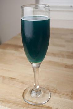 Purple Nurple:          1 shot coconut rum      1 shot orange liqueur      1/2 shot blue curacao      2 shots cranberry juice    In a shaker add ice, rum, orange liqueur, blue curacao and cranberry juice.  Shake it up real good and strain it into your cocktail glass.