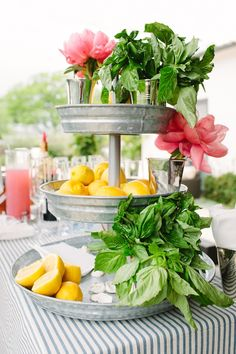 summer flowers arranged in cake pan stand