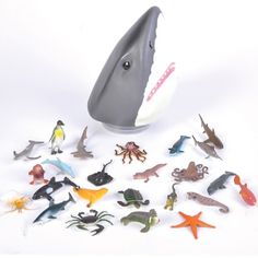 Shark Head Case at theBIGzoo.com. The case would make a great centerpiece or cake topper, while the figures inside would make great table confetti, party favors, or cupcake toppers.