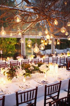 table settings, hanging lights, tent, rustic weddings, lighting ideas, tree branches, long tables, parti, reception lighting