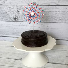 simple DIY firework cake topper:  Made with paper straws.