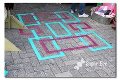 """craft fair booth - duct tape """"rug"""""""
