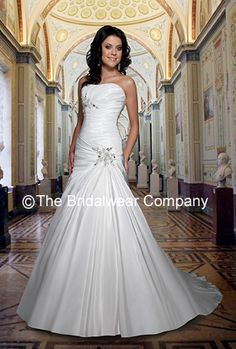 Taffeta wedding dress with sweetheart neckline.  Tiny hand beaded appliques and mirrored rhinestones have been used on this dress to decorate the dropped waist at the hip, and also to one side at the bust. The pleated bodice gives a wonderfully flattering shape. A-line skirt.    This wedding dress is available in Diamond White and White. PERFECT