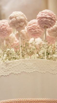 Ruffle cake pops by Sweet Bloom Cakes, styled with baby's breath