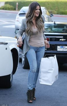 Retail therapy: Khloe Kardashian carried home the goods after a light shopping trip in Woodland Hills, California on Thursday