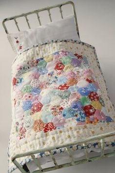 doll bed with bedding