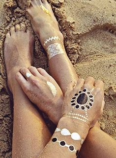 Romantic. Eclectic. Organic. Transform your look with this set of jewelry inspired temporary tattoos. The possibilities are endless with this set of black, gold and silver designs. Easy application and lasts about 4-6 days by Flash Tattoos, $22.00