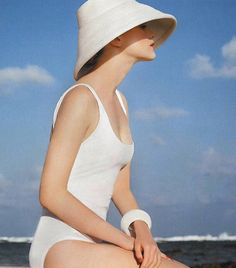 White Bathing Suit, bracelet, and hat FROM: The Coolest Instagram Pics You Missed This Week