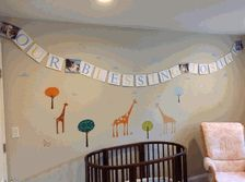 Photo Banner for Dedication - God Bless Josiah with beautiful photos in Light Blue and Bright Yellow custom banner now hanging in baby's room from settocelebrate.com