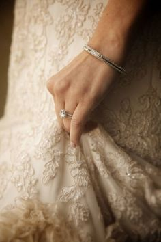 wedding - ring hand holding dress. Ring and dress detail in one shot