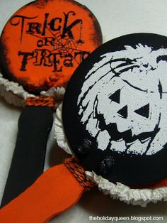 Halloween Noisemaker Clackers DIY #Halloween  Wooden clackers painted, stamped, embossed and trimmed with crepe paper garland.