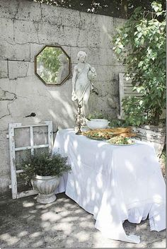love a mirror in the garden