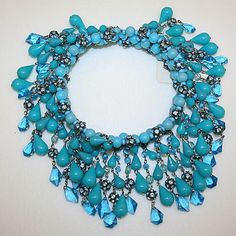 Necklace  House of Dior  (French, founded 1947)   Designer: Attributed to Marc Bohan (French, born 1926) Date: ca. 1965 Culture: French   Medium: plastic, glass, metal Dimensions: Diameter: 5 in. (12.7 cm) .