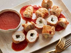 Roll up fontina cheese and sage inside tender chicken cutlets, then simmer the meat in a tomato-wine sauce for Giada's Easy Chicken Roll-Ups. #RecipeOfTheDay