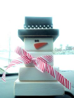 snowman made out of wood blocks