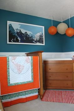 Love a #turquoise #nursery with #orange and #white accessories.  #lanterns