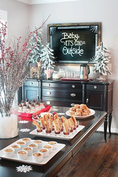 """Beautiful Christmas party set up... I love the """"Baby It's Cold Outside"""" Sign <3"""