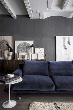 grey wall blue sofa