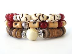 A very cool summer bracelet stack featuring coconut shell wheel beads, a ceramic focal bead, bone beads, 8mm red coral beads and pewter accent beads. This beaded stretch bracelet set is the perfect accessory for summer. Wear stacked as shown or individually for a more simple statement. A must-have accessory for any wardrobe!