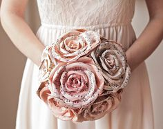 This sheet music bouquet is seriously cool. Maybe my bouquet would be real flowers and the bridesmaids could be the musical note flowers. :) paper roses, bridal bouquets, flower bouquets, wedding bouquets, bride bouquets, wedding flowers, rustic weddings, sheet music, music sheets