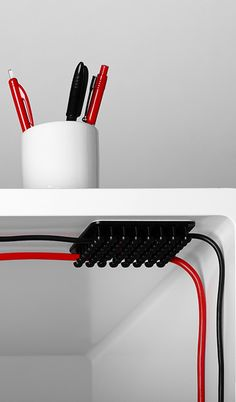 Tangled power cords don't stand a chance against this Cablox Cable Organizer.