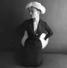 Ivy Nicholson wearing suit, hat and white fox muff by Dior,, photo by Milton Greene for LIFE, September 8, 1952