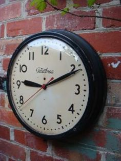 """Vintage School Clock.  Notice the totally non-digitalness of the time piece. Yes, we all had to learn to """"tell time."""""""