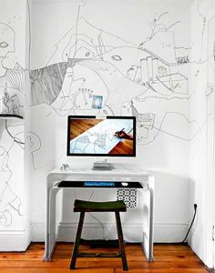 Wall art! A minimal modern desk clears the clutter so the mind is free to roam.  Juxtaposition is everything.