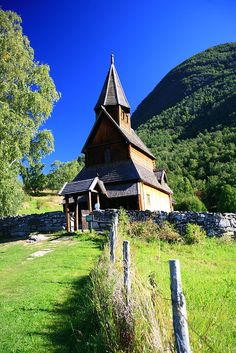 Urnes Stave Church, Norway... the blue in the background is amazing!