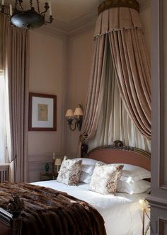 London pied-a-terre of Paolo Moschino and Philip Vergeylen. #interiordesign #London  I love the weight and draping of the canopy, the linen bedding and fur blanket.
