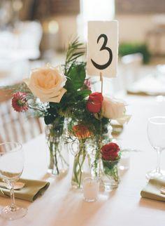 romantic centerpiece, photo by Jeffrey C. Gleason Photography http://ruffledblog.com/natural-romantic-wedding-with-macrame-details #weddingideas #centerpieces #tablenumbers