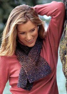 Knitted Scarf with Slit  Have made several of these.  Easy to make and toasty warm on your neck.
