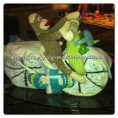 Baby boy shower gift , diaper cake   Motorcycle  Sock monkey  http://www.etsy.com/shop/DivaliciousDiapers  Divalicious diaper creations on etsy  Custom made baby shower gifts, hospital gifts ,  first birthday gifts   Made to order , any theme , sport ,  nursery themes