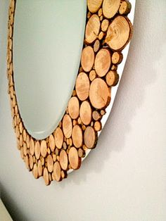 DIY - A circular mirror with wood slices all around.