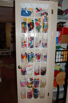 Organizing the kids craft stuff, over-the-door version by Just Deanna.  Possibly more feasable than the rolling cart with a desk, and you could put the by-permission-only supplies at the top (I see she, too, put the paints out of reach).