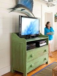 Old dresser with a drawer removed to create a media console...love this idea!